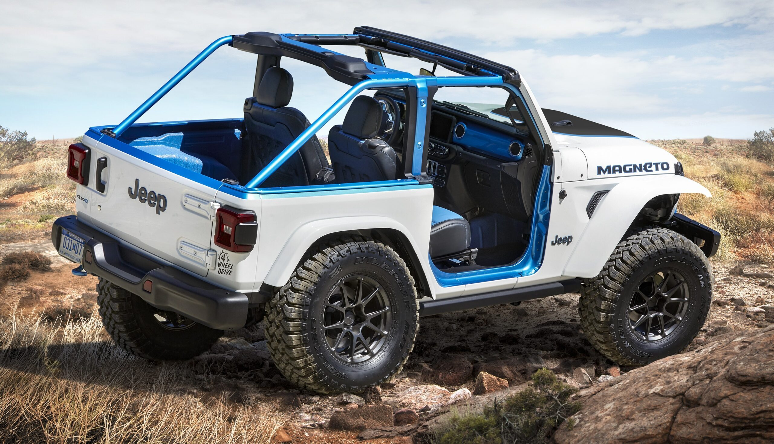 A rear view of the Jeep Magneto along a truck trail