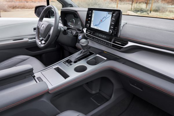 2021 Toyota Sienna front seat features with the under-console storage area.