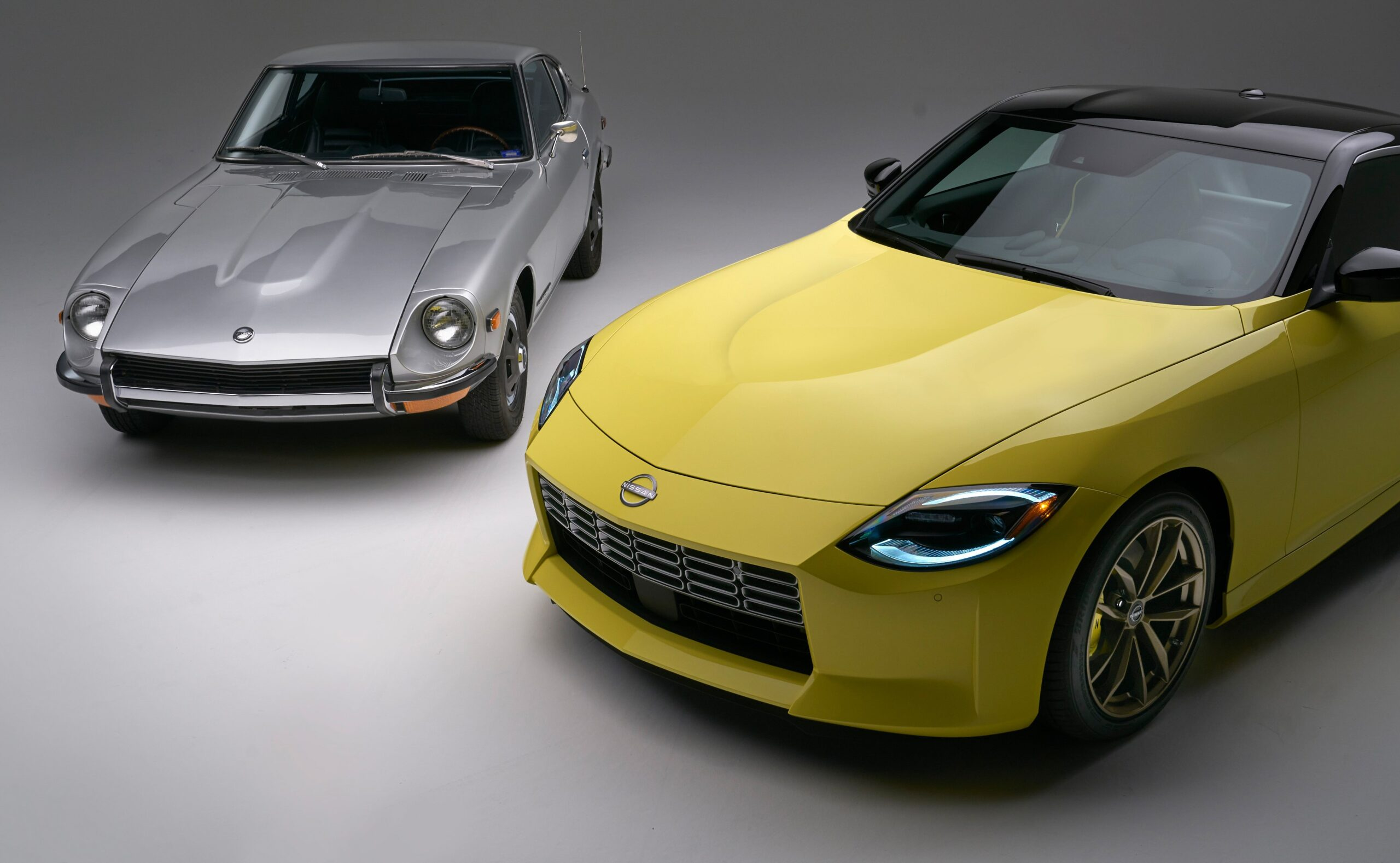 An image of the first and latest generations of the Nissan Z
